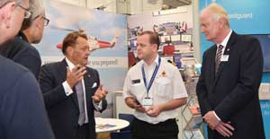 The Minister for Transport and British Marine CEO Howard Pridding on the MCA stand at the Southampton Boat Show